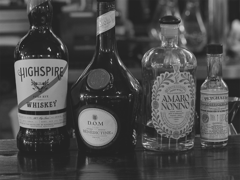 Black and White Photograph of Craft Cocktail Ingredients in Bar